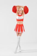 Beautiful cheerleader on light background
