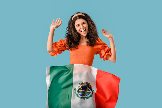 Young happy woman with Mexican flag on color background