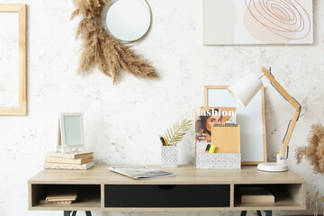 Stylish workplace in interior of room