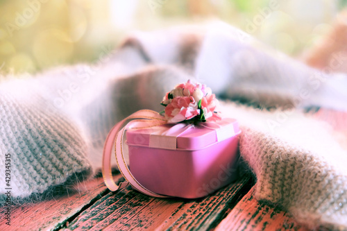 Blurred luxury pink gift box on pink wooden background,  Copy space. Concept holiday. Happy Woman's Day, Mother's Day, Valentine's Day, Wedding. Country style. Toned