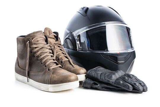 Safety motorcycle accessories. Leather gloves, helmet and shoes isolated on white background.