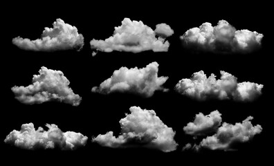Fototapeta Collections of separate white clouds on a black background have real clouds. White cloud isolated on a black background realistic cloud. white fluffy cumulus cloud isolated cutout on black background