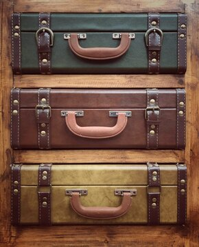 A stack of vintage or old fashioned leather suitcases or luggage in a travel background with copy space