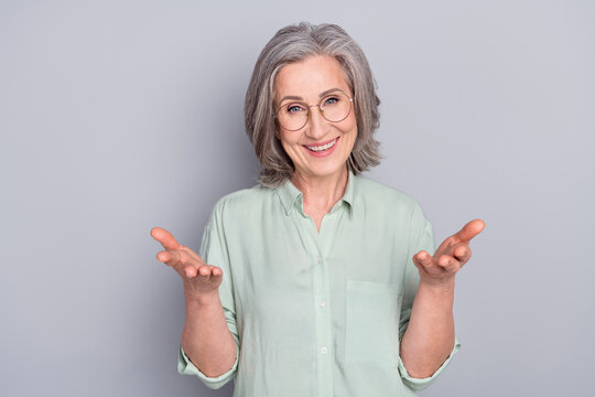 Photo of happy excited positive good mood mature woman talking communicating isolated on grey color background