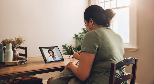 Woman having telemedicine appointment with doctor