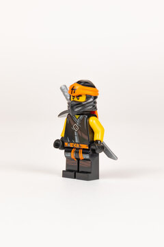 Hero toy Cole with a sword from a set of lego ninjago on a white background. close-up