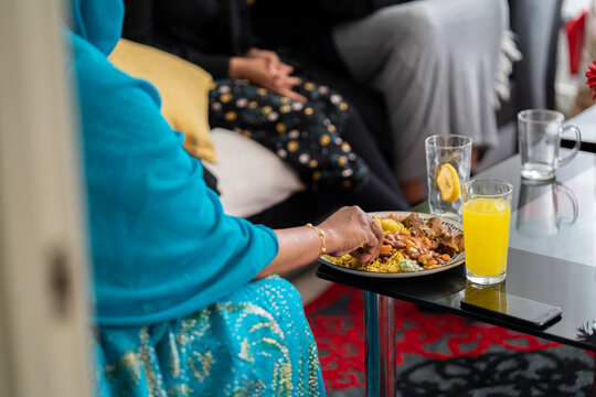 Woman eating food in traditional Somali dress