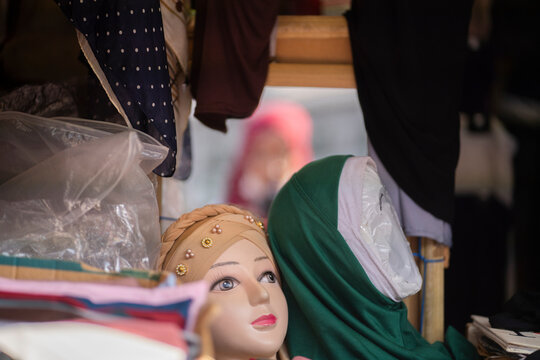 Hijab styles demonstrated on shop mannequin head