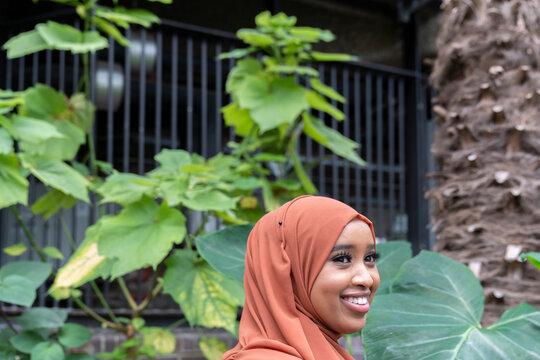 Black Muslim Woman standing in nature