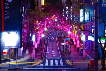 A night illuminated street in Shibuya middle shot