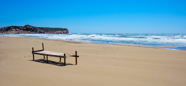 wooden seat near the sea at the beach