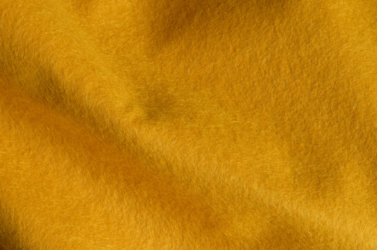 yellow felt fabric texture for background.