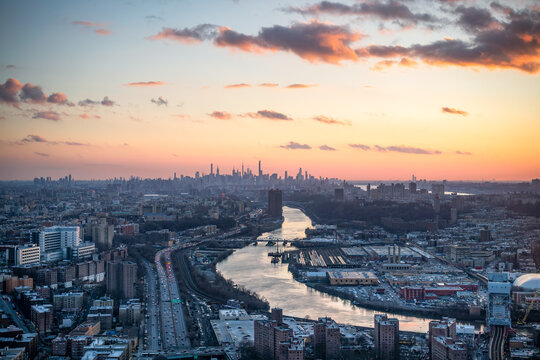 Aerial view of outer New York area with Manhattan Skyline in the background and Harlem River