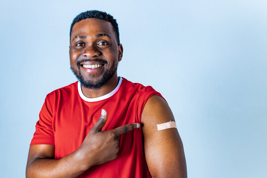 afro american sportsman showing his arm after receiving a vaccine in studio