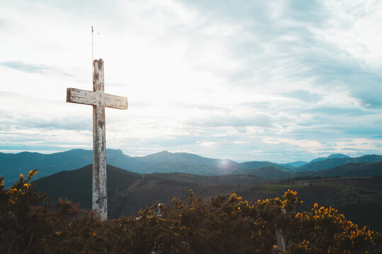 Christian cross on top of a mountain in Basque Country on a cloudy day