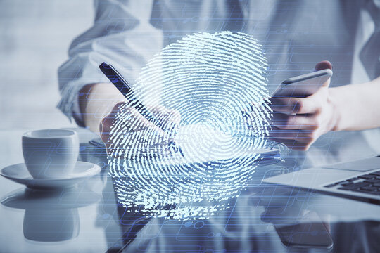 Double exposure of fingerprint hologram and woman holding and using a mobile device. Security concept.