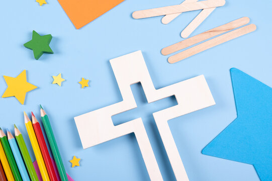 Vacation Bible School craft supply with wooden cross. Christian concept.  Copy space text. Selective focus.