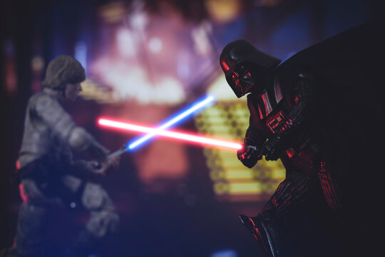 NEW YORK USA, APRIL 25 2021: scene from Star Wars The Empire Strikes Back, Jedi Luke SKywalker battles Sith Lord Darth Vader with lightsabers - Hasbro action figures