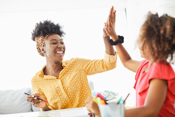 Fototapeta homework teaching girl high five education mother children daughter familiy childhood success child african american obraz