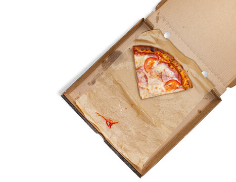 Box with pizza leftovers, top view, on white isolated.