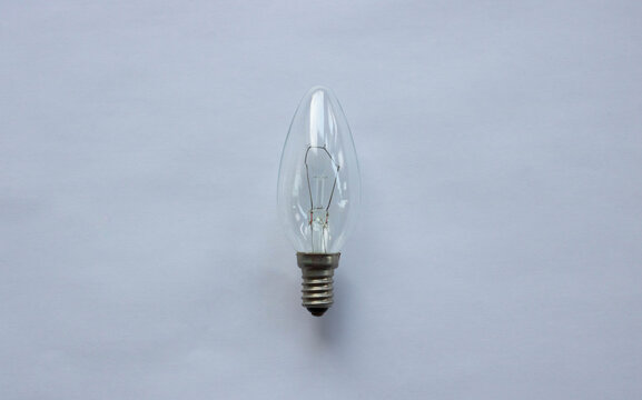 Small tungsten light bulb isolated on white background