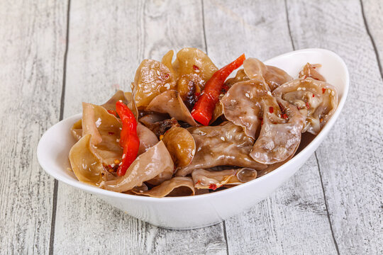 Marinated pork ears with pepper