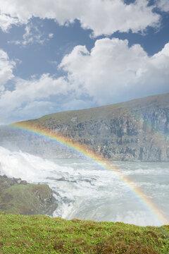 Iceland, Gullfoss waterfall. Captivating scene with rainbow of Gullfoss waterfall