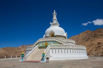 Fototapeta White buddhist stupa or pagoda in tibetan monastery near village Leh in ladakh, noth India