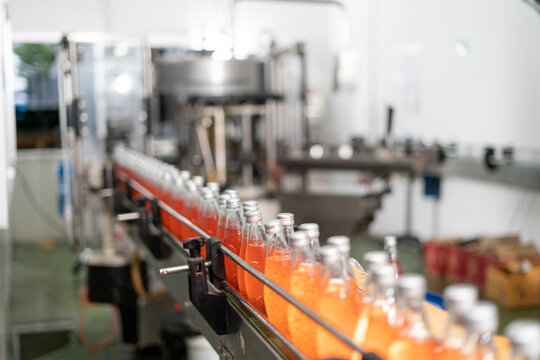 Production line for drinking water, fruit juice and liquid medicine in the factory. Sterilized and sterilized bottle filling machines