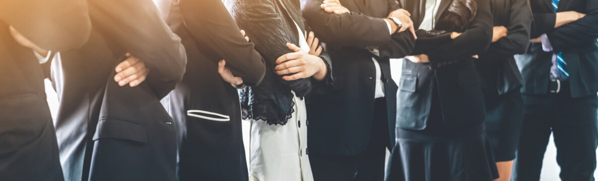 Many business people meeting standing in row with arms crossed and confident. Company organization employee unity and support. Concept of corporate partnership and human resources growth management.