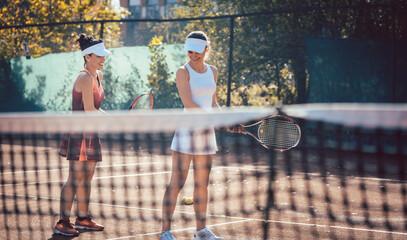 Fototapeta Tennis coach teaching woman in the game