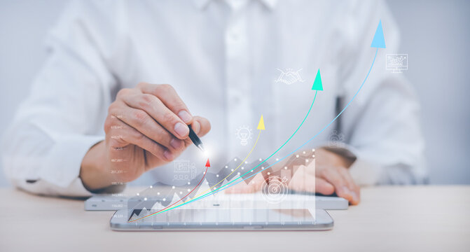 Business analytics and financial concept, Plans to increase business growth and an increase ,Technology and Business trend analysis concepts, with business graphs coming out on the computer notebook.