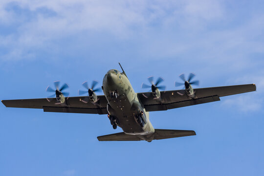 A Royal Air Force Lockheed C-130J 'Super Hercules' performing tactical landings and takeoffs from the public beach at Cefn Sidan Sands in West Wales.