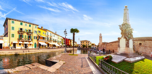 View of Lazise at the lakeside of Lake Garda in summer in the northern Italy. Lazise is a popular holiday location in Italy.