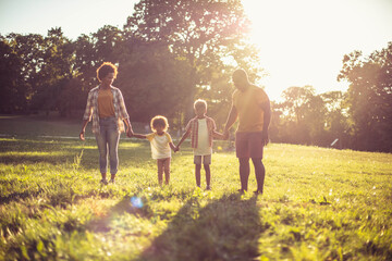 Fototapeta  African American family walking trough nature. obraz