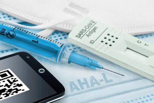 Massnahmen Corona Konzept Impfung Test Handy Maske