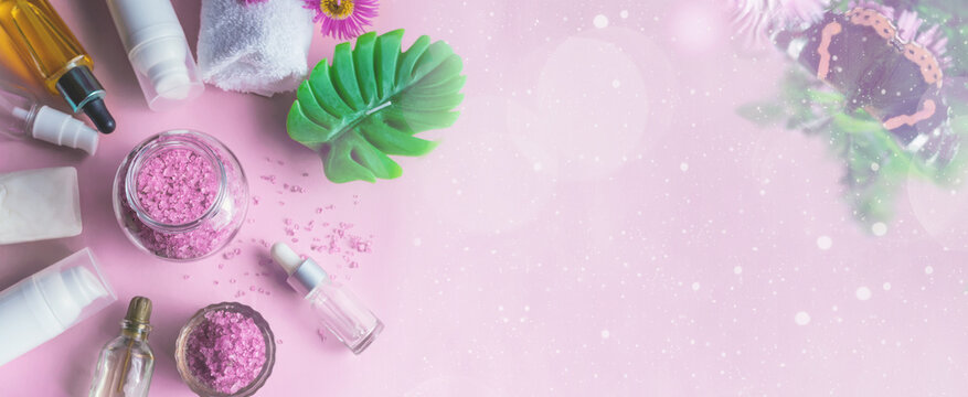 Lavender sea salt with natural spa products and on a pink background. copy space. Banner