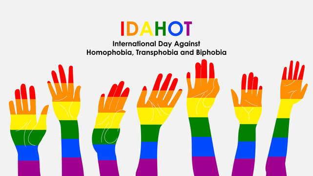 The International Day Against Homophobia, Transphobia and Biphobia. Hands raised in the air decorated in the colors of the LGBT flag. Template for background, banner, poster with text inscription.