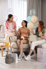 Fototapeta Happy pregnant woman spending time with friends at baby shower party