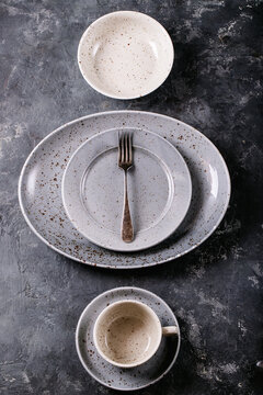A blue modern ceramic plate with silver fork