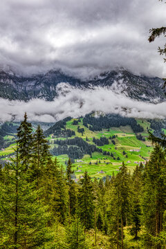 A view of the Swiss Alps with huge clouds in the sky