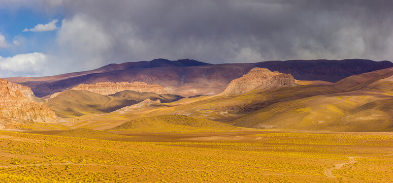 Panoramic view of a colorful mountain landscape in the volcanic active area in the vicinity of Antofagasta de la Sierra on the high altitude puna, northwest Argentina