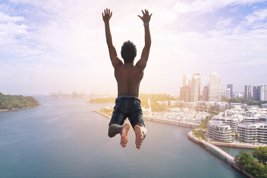 Man jumping into lake or river. freedom concept, Flying freely to the sky. Summer vacation lifestyle