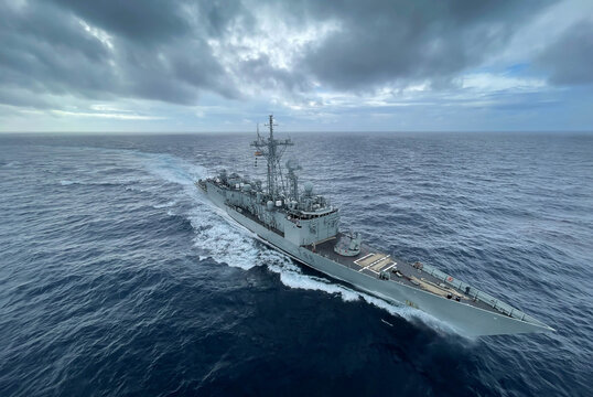 military us navy ship sailing in the ocean during nato operation