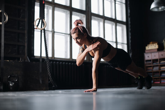 Young girl doing sports in the gym. Atmospheric gym