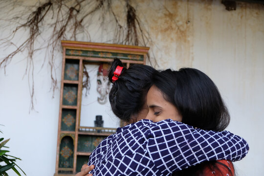 Indian female friends hugging and comforting each other