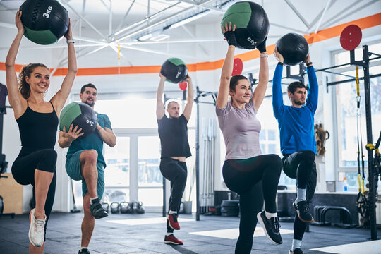 Well-built Caucasian men and women working out together