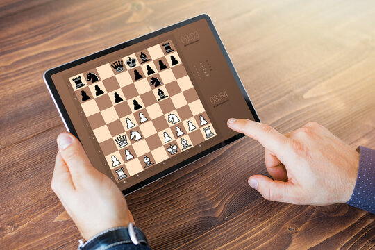 Man playing chess online on tablet computer