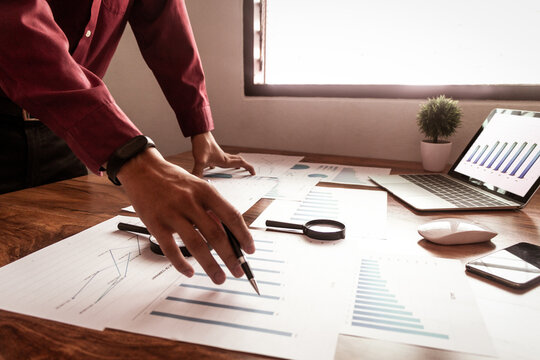 Business analysts data of the company,data and statistics from the chart,strategy concept,In the afternoon.