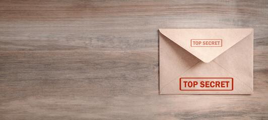 Fototapeta Envelope with top secret stamp on wooden table. obraz